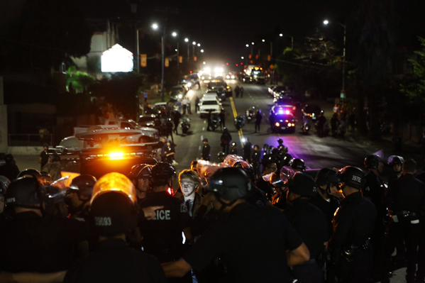 LAPD on speakerphone gives dispersal orders making clear to Ferguson protesters that they will be arrested unless they do so.