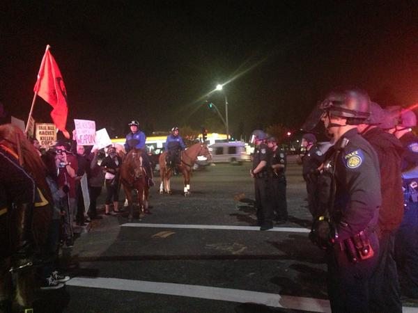 Protesters surrounded now by officers. Sacramento Ferguson