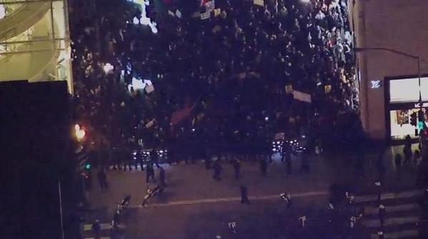 Police standoff with protesters at SF's Stockton Street preventing them from disrupting tree lighting