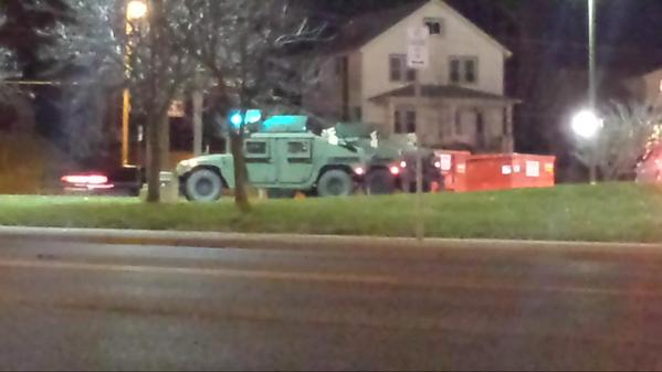 Military trucks every corner. Helicopters whirling in Ferguson, MO
