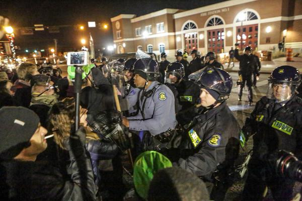 Police Aggressively Confront Protesters In Front Of Ferguson Police Department