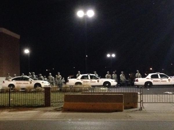 There's a line of National Guard in the police station parking lot