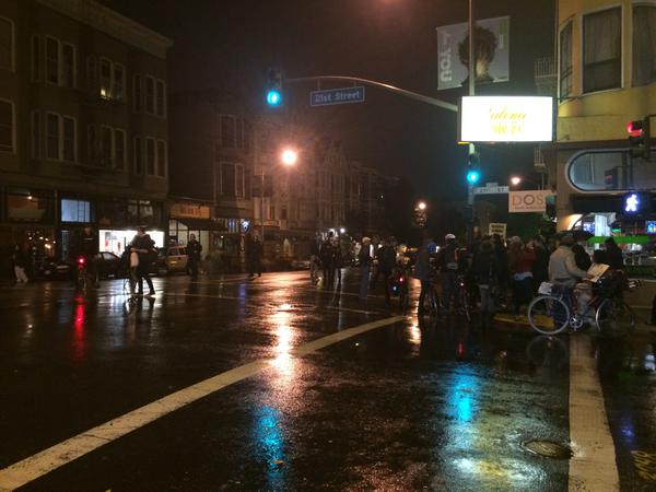 Handful of Ferguson protesters still at 21st in SF. Police preventing them from marching down Valencia