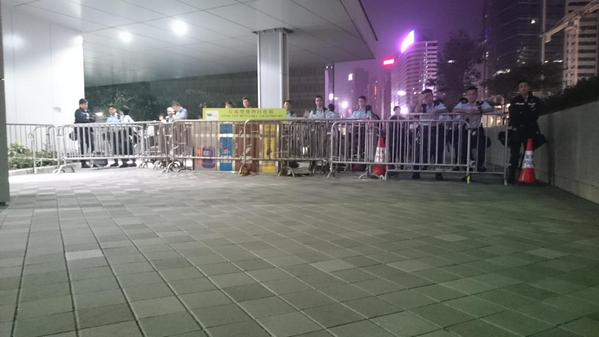 Police are already all over the Gov entrance & are scoping out protesters. OccupyHK UmbrellaMovement