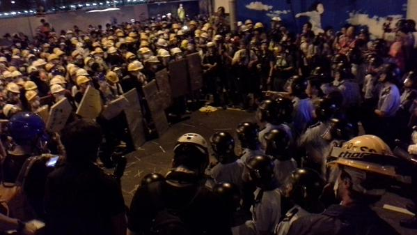 Standoff between protesters and the police on the east end of Lung Wo Road.