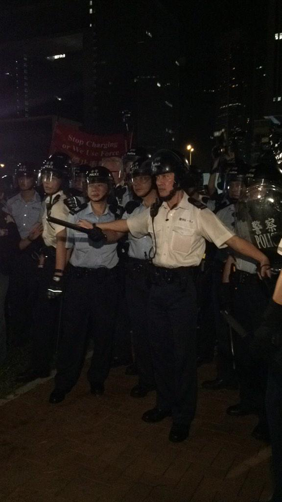 Police retreat & some hold protesters back from charging