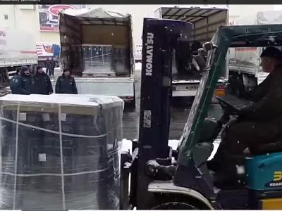 Black crates inside Humanitarian trucks