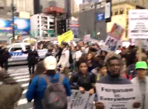 Ferguson protesters in New York marching in the middle of the street