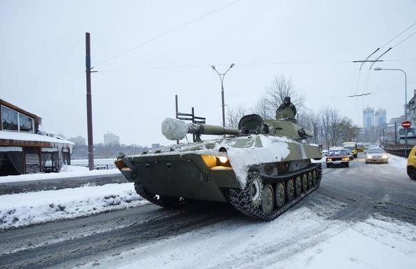 Militants in Luhansk move heavy equipment.
