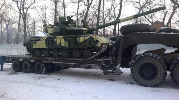 A T-64 main battle tank, modernised by the Kharkiv plant, gets shipped off to a frontline unit in east Ukraine today