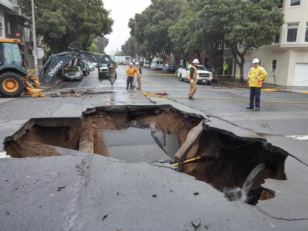 Large sinkhole opens up in streets of San Francisco as storm brings heavy rain