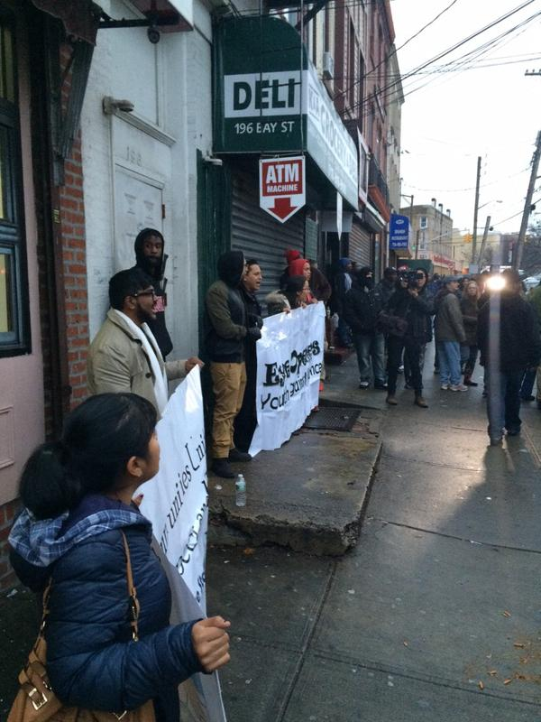 Roughly 20 protesters outside the Staten Island convenience store where Eric Garner was killed