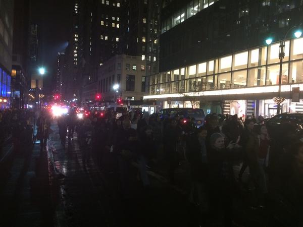 Protesters marching west on 42nd street blocking traffic. EricGarner I can't breathe.
