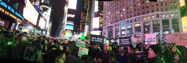 Hundreds of peaceful protestors in Times Square now heading to Rockefeller center EricGarner