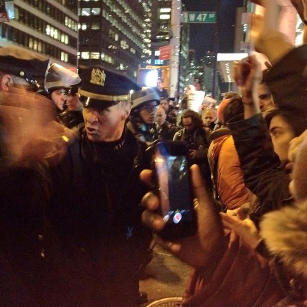 Things getting tense between NYPD and EricGarner protesters at 47th and 6th. At least 5 arrested people are saying