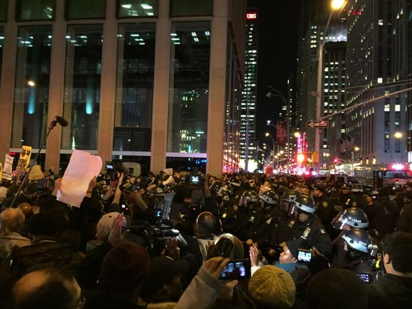 Arrests going down at 47th and 6th Avenue. Massive standoff between police and protesters.