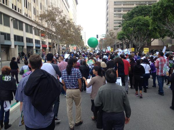 100s marching down streets of DTLA to RaiseTheWage