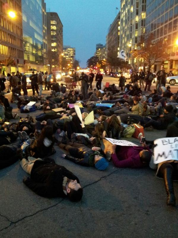 Washington DC. Penn Ave and 17th, chanting. Die in.