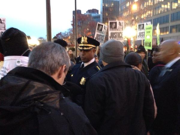 City police commish Anthony Batts meets with protestors at McKeldin square
