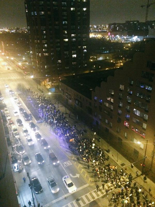 Protesters head south on State St. in Chicago shouting, don't shoot, hands up