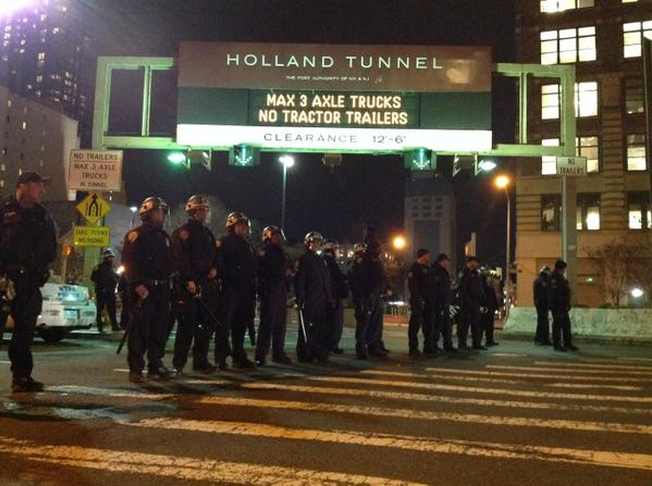 Line of officers in riot gear protecting Holland Tunnel