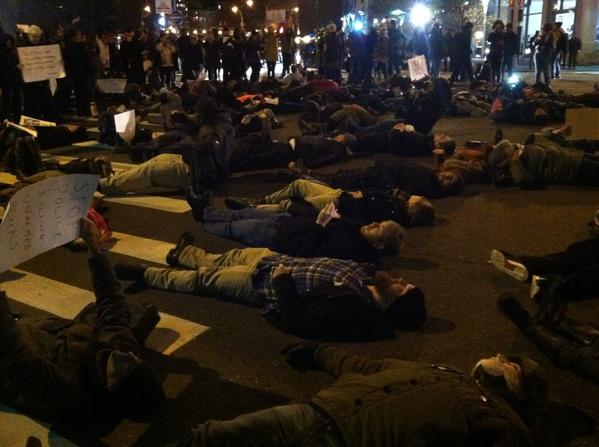 Die-in at the intersection of Canal and Sixth Ave blocking traffic in all directions. EricGarner
