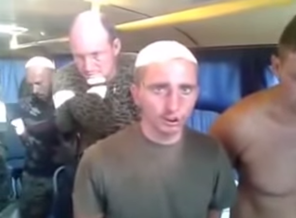 Traditional Soviet humiliation ritual: ukrainian POWs forced to sing USSR anthem