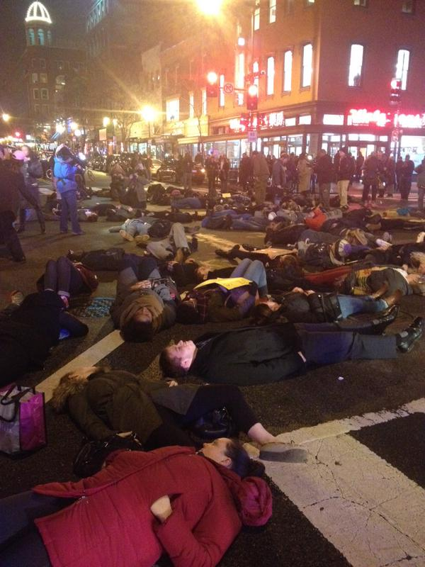 About 40 people lying on the street in Alexandria, VA in a moment of silence