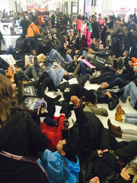 Die-in Macy's 34th street chanting Eric garner, Michael brown shut it down! Shut it down!