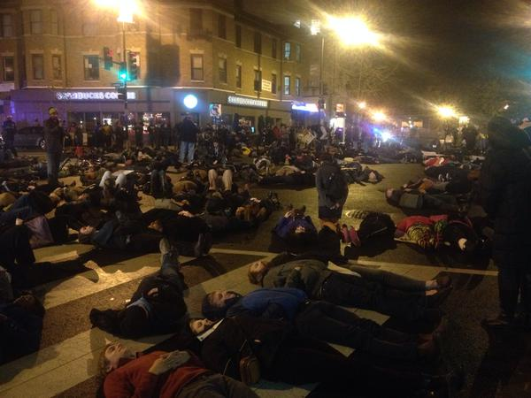 Die In for EricGarner in Adams Morgan, DC tonight. 100 plus demonstrating in silence.