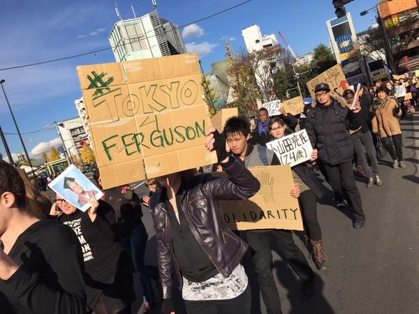 Protesters in Tokyo standing with protesters in the US