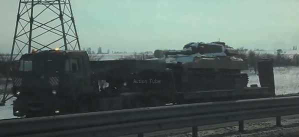A Russian army convoy transports 2S1 howitzers to the Ukrainian