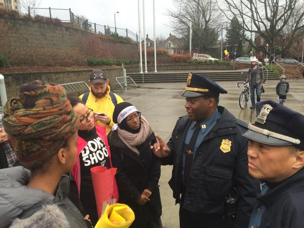.@seattlePD and protest organizers talking before today's march in support of MichaelBrown and EricGarner