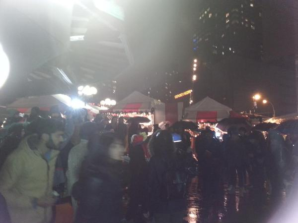 Crowd of 100 have assembled in center of Union Square