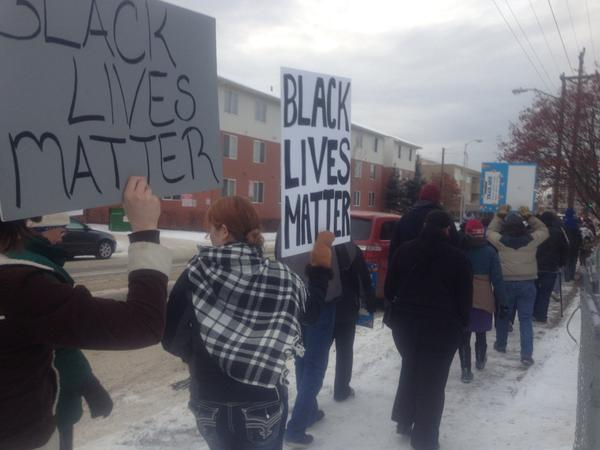 In Alaska About 120 people in downtown Anchorage chanting Hands up, don't shoot.