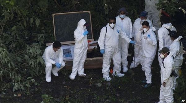 First of missing 43 Mexican student teachers identified from charred remains on rubbish dump