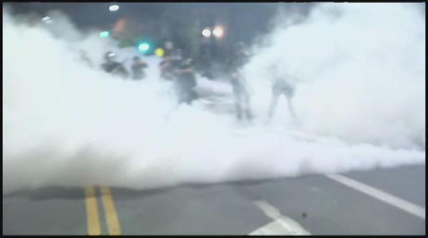 Berkeley Police use tear gas to break up EricGarner protests.Double meaning to ICantBreathe for protestors.