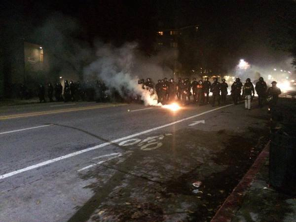 Berkeley police shooting rounds of tear gas and marching down the street. berkeleyprotests