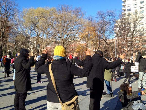 HandsUpDontShoot chant now at Washington Square Park, New York