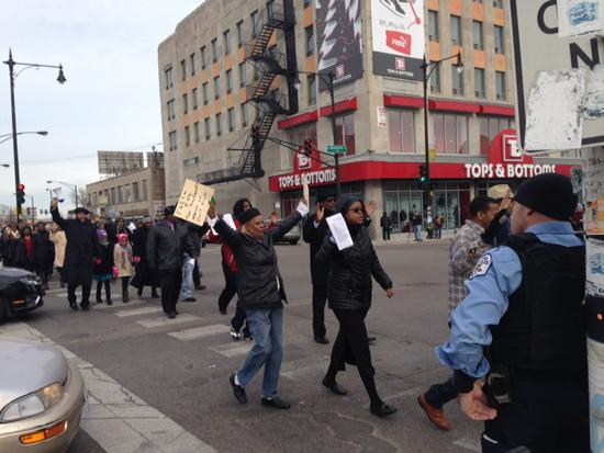 Demonstrators circle all four corners of Pulaski & Madison. Chants of 'No justice no peace!'