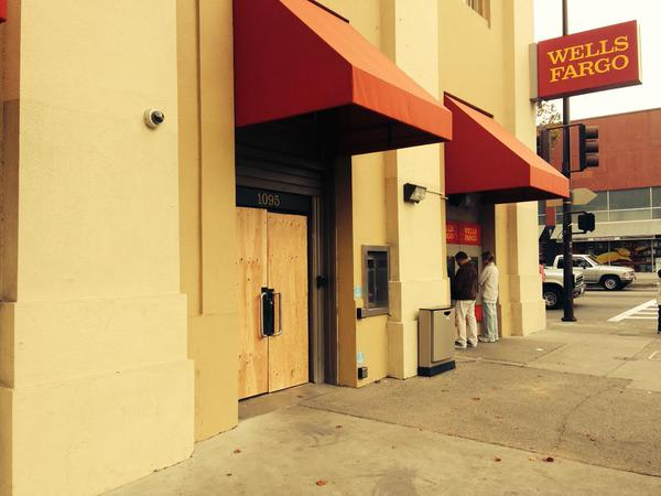 The doors and windows of Wellsfargo on San Pablo are covered w/ plywood after being broken in berkeleyprotests