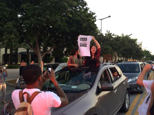 People in cars join in chanting at the shutitdown protests Miami