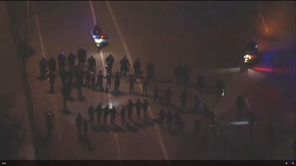 Cops and protestors clashing in berkeleyprotest right now on highway