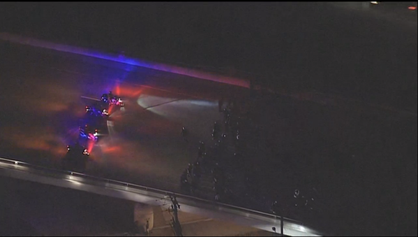 Police using motorcycles & skirmish line to move berkeley protesters down freeway