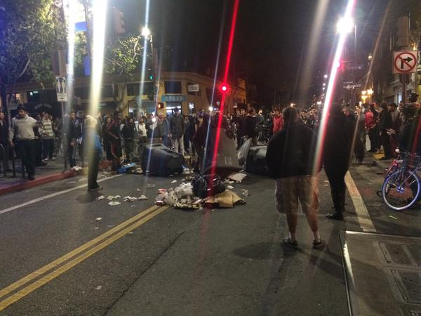 """Masked group starting fire, as many yell """"That's not the point!"""" Getting tense. BerkeleyProstest"""