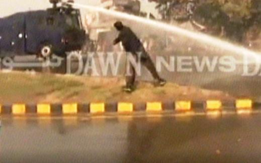 Screengrab shows police dispelling protesters using water cannons in Faisalabad