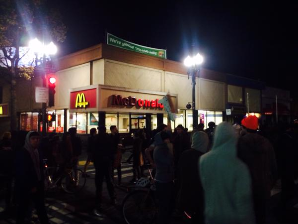 People throw things into windows of McDonalds and other shops berkeleyprotests