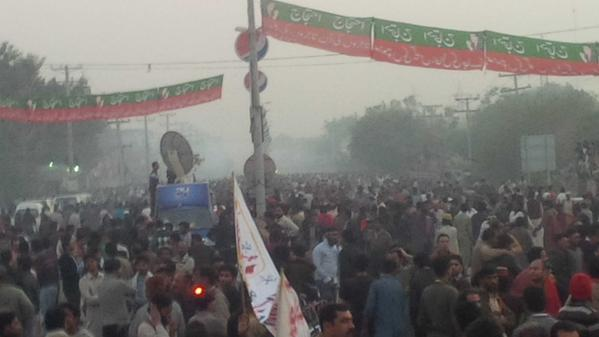 Rally in Faisalabad. Smoke in the background