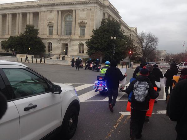 Protesters want to walk down Constitution Ave. police keeping them on sidewalk. Only about 2 dozen