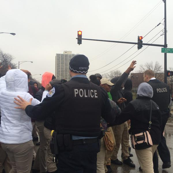 HS students block traffic 63 & Stony. Chicago PD tries to move students